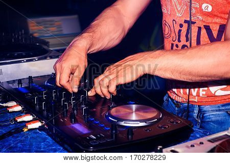 professional music equipment for playing and control the music in the nightclub with your hands DJ