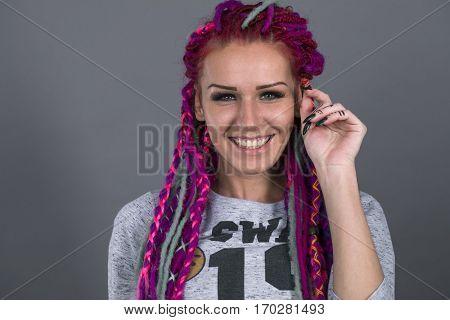 Sexual girl with fascinating dreadlocks posing in studio. Acid style