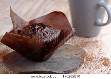Chocolate muffins in baking paper