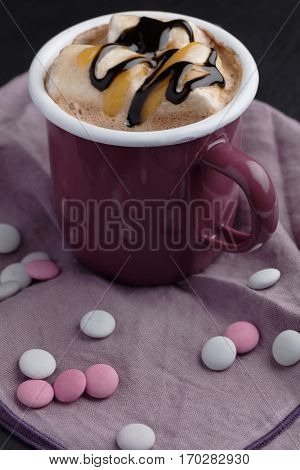 Hot chocolate with marshmallow, caramel and liquorice sauce