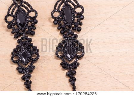 earrings on a wooden background a great gift for the woman he loves