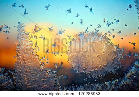 Frozen window glass over sunset background