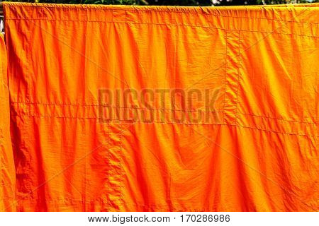 yellow monk cloth wash and dry on clothes line