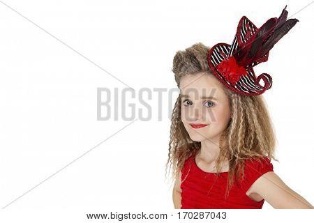 Portrait of school girl wearing headgear over white background