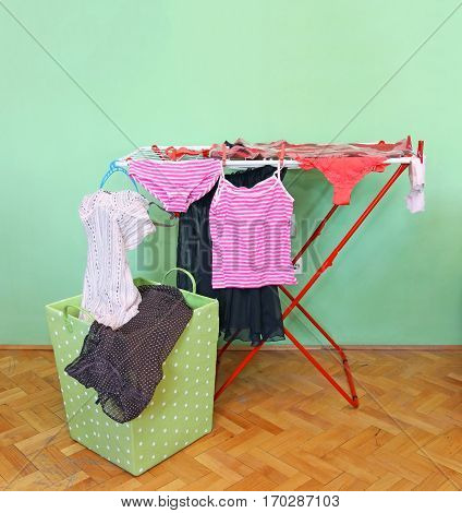 Female wet clothing hanging from dryer rack