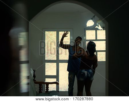 Social issues aggression and violence on women alcoholic black man hitting and beating woman at home. Domestic fight with aggressive husband and abused wife crying