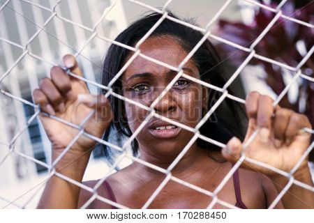 Social issues abuse and violence on women. Depressed girl sad african american young woman crying at home. Abused and scared wife