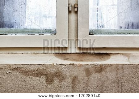 Damage caused by of damp on a wall in house