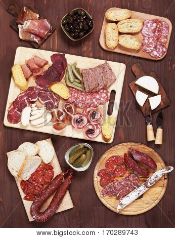 Charcuterie board with cured meat, olives, bread and cheese