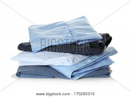 Clean clothes from dry-cleaning on white background