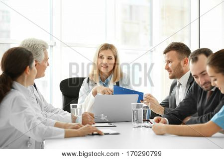 Team of doctors having meeting in clinic