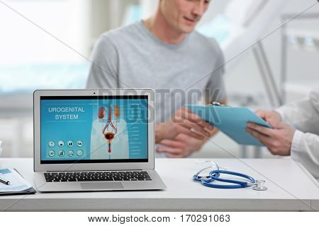 Medical concept. Laptop screen with urology system image on doctor's desk