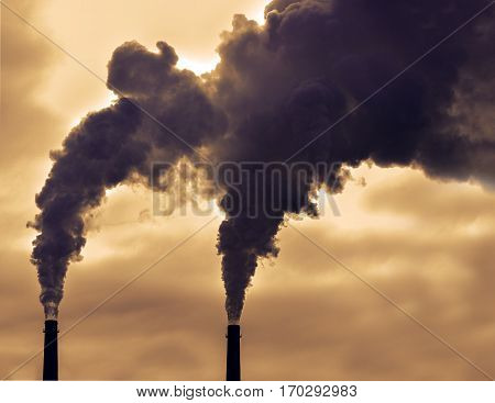 Poisoned emissions from towers. Poisonous violet emissions from the production of goods, day, outdoor