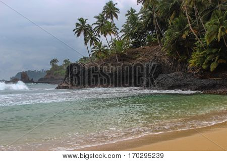 Beautiful beach with volcanic rocks and clear water in Sao Tome and Principe Island, in Africa
