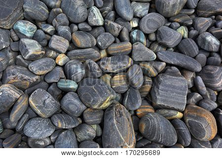 Gray striped pebble as a background
