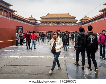 Beijing, China - Oct 30, 2016: Visitors at Meridian Gate (Wumen); the main gateway into the Forbidden City (Gu Gong, Palace Museum).