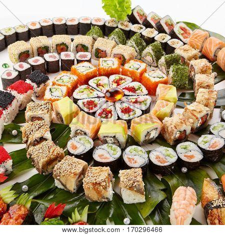 Japanese Sushi Set - Various Maki Sushi Roll and Nigiri Sushi Served on Banana Leaf