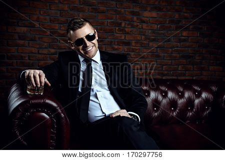 Business, success and luxury concept. Portrait of a respectable modern mature man in luxurious apartments.