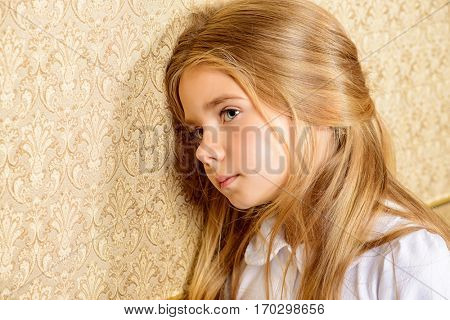 Portrait of a sad little girl.
