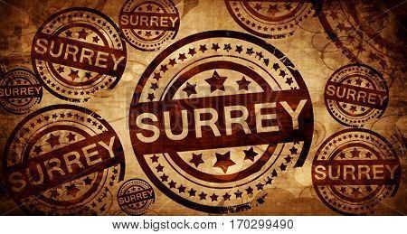 Surrey, vintage stamp on paper background