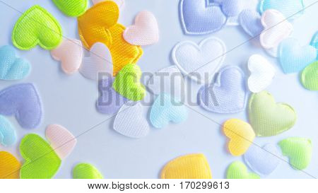 Scattered satin hearts colorful background Valentine's Day