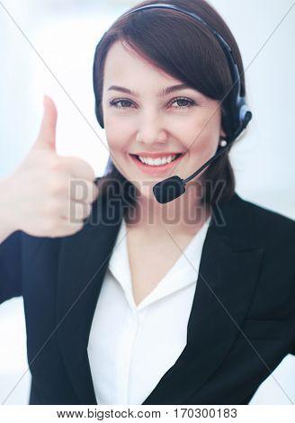 Beautiful woman working at callcenter, using headset showing thu