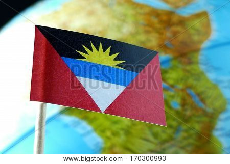 Antigua And Barbuda Flag With A Globe Map As A Background Macro