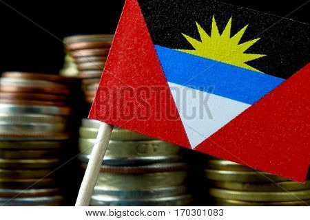 Antigua And Barbuda Flag Waving With Stack Of Money Coins Macro