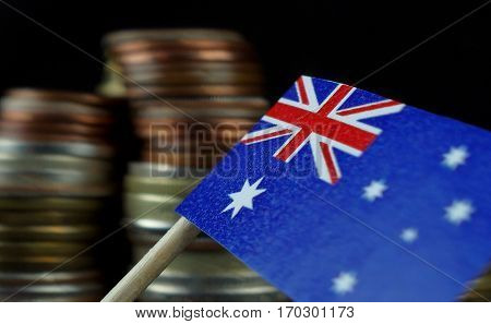 Australian Flag Waving With Stack Of Money Coins Macro