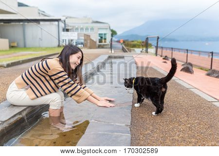 Woman play with cat
