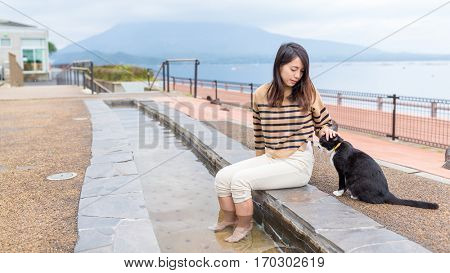 Woman play with kitten at outdoor