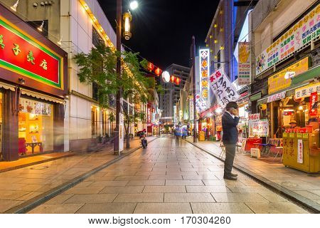 YOKOHAMA, JAPAN - NOVEMBER 7, 2016 : People in Chinatown district of Yokohama at night, Japan. Chinatown of Yokohama is the largest chinatown in Asia.