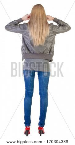 back view of  beautiful blonde Young woman thinking.  girl in jacket, jeans and red kitten heels. Rear view people collection.  backside view of person.  Isolated over white background