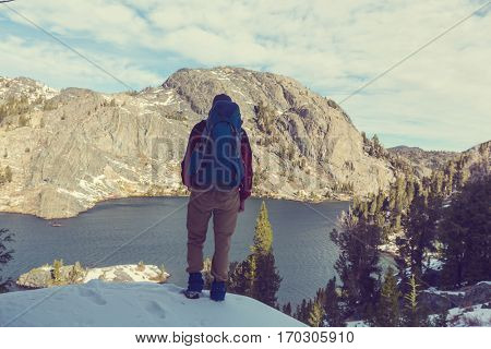 Man with hiking equipment walking in Sierra Nevada  mountains,California,USA