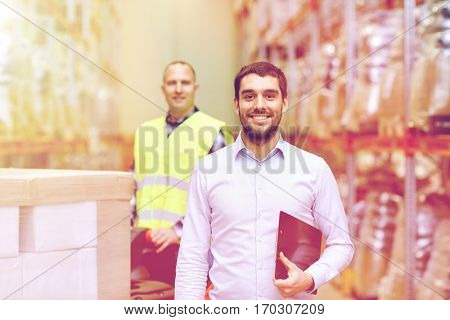 wholesale, logistic, business, export and people concept - happy man or manager with clipboard at warehouse over loader on forklift