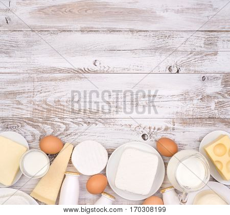 Dairy products on wooden background with copy space