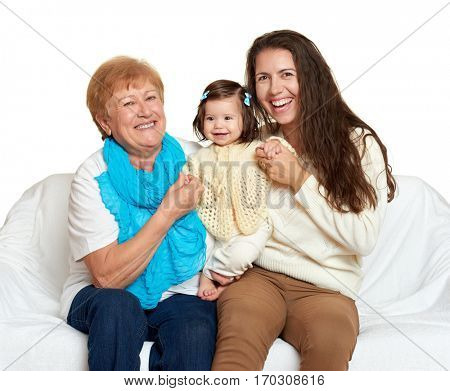 Children with mother and grandmother. Family portrait on white background, happy people sit on sofa.