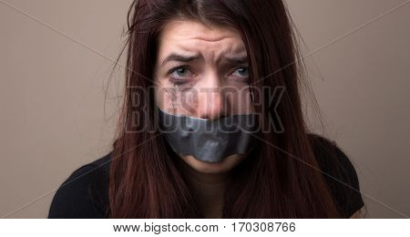 Frightened girl hostage with tape