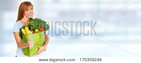Woman with Grocery shopping bag.