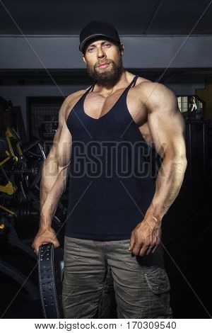 An image of a bearded muscular man in the gym