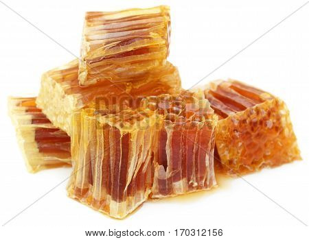 Closeup of Honey comb over white background