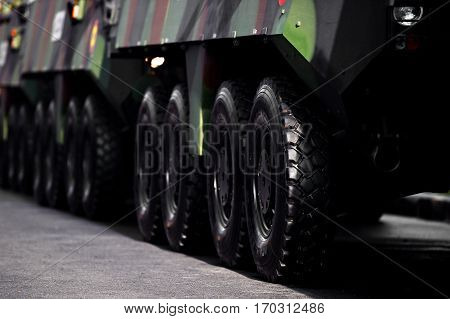 Detail shot with armored vehicle wheels during military parade