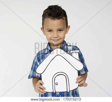 Boy Holding Papercraft Home Icon Family