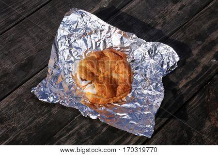 croissant. breakfast croissant. egg, cheese, bacon croissant on aluminum foil for breakfast.
