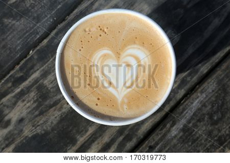 latte. latte with a heart design. paper coffee cup. breast cancer awareness. coffee