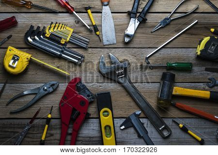 Old tools on a wooden table, top view