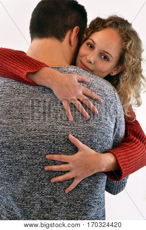 Young couple hug in love bag view