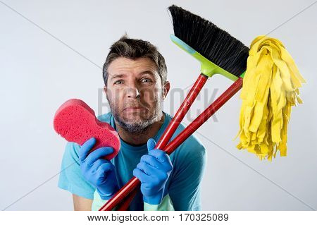 portrait young domestic service cleaner man or stressed husband doing housework washing home with sponge mop and broom in stress looking tired and desperate in boring cleaning work concept poster