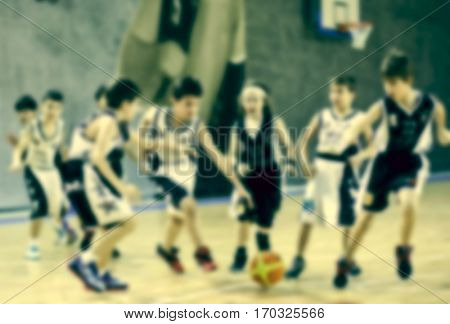 blurred background of children playing basketball