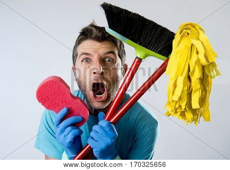 portrait young domestic service cleaner man or stressed husband doing housework washing home with sponge mop and broom in stress screaming crazy desperate in boring cleaning work